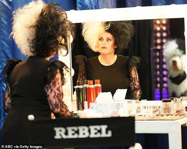 Mugging for the Camera: And in a few new photos on set, she could be spotted in unparalleled Cruella gear while standing in front of her makeup mirror.