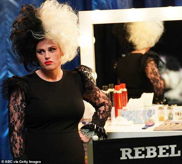Hard Work: Rebel Wilson channeled dog-hating character Cruella De Vil in a cheeky costume for his new show Pooch Perfect